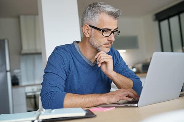 Man-Researching-Laptop-Crowdfunding-Platforms