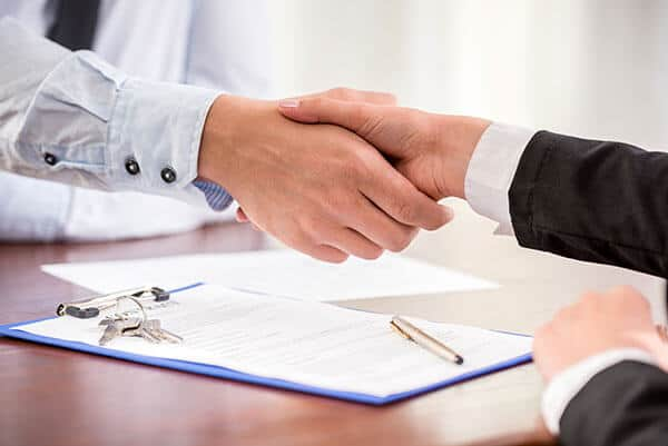 Handshake-Handing-Over-Keys-Private-Notes-and-Mortgages