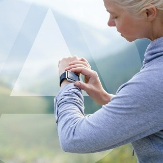 Woman checks her heart rate on her fitness watch