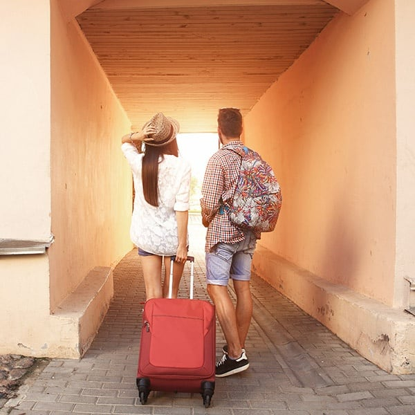 Young couple walks to their vacation destination