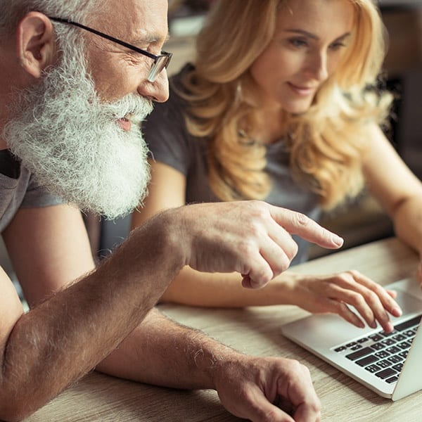 Couple looks at computer together