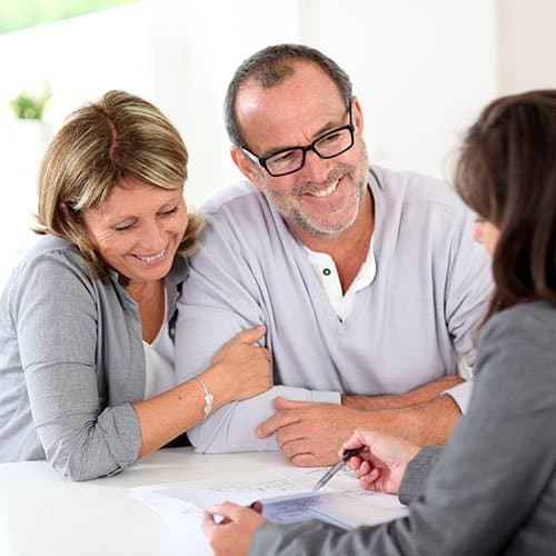 Older couple works with a professional and looks pleased