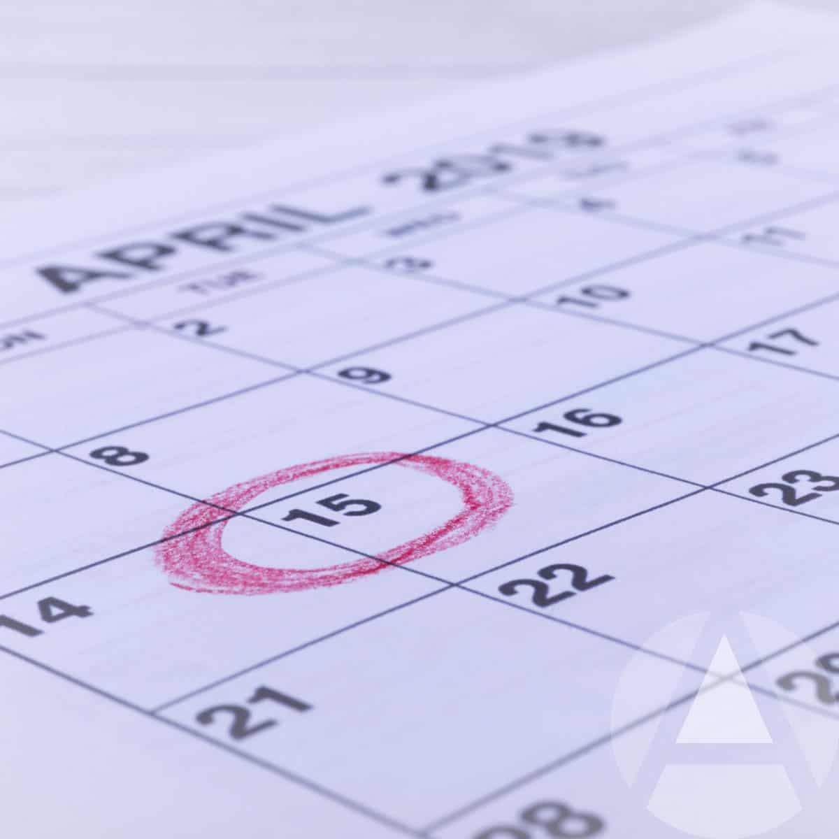Tax day circled on the desk calendar