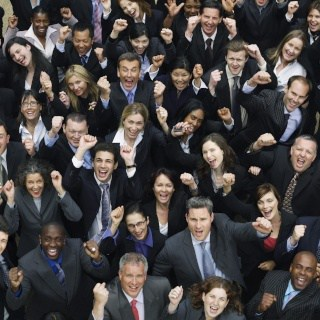 Crowd of business employees looks excited