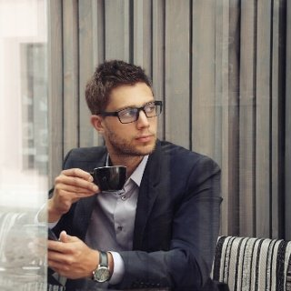 Young professional man drinks coffee