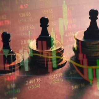 Chess pieces sit on top of coins with stock market overlay
