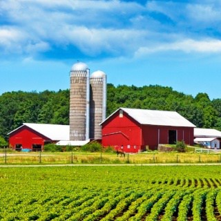 Iconic farm with red buildings and silos