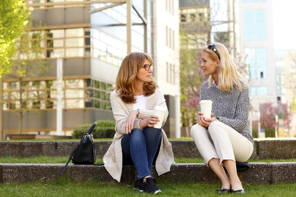 Woman telling her friend about the benefits of self-directed iras
