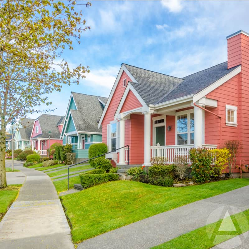 Bright pink and blue homes on a lush, green landscaped corner are examples of off-market real estate.